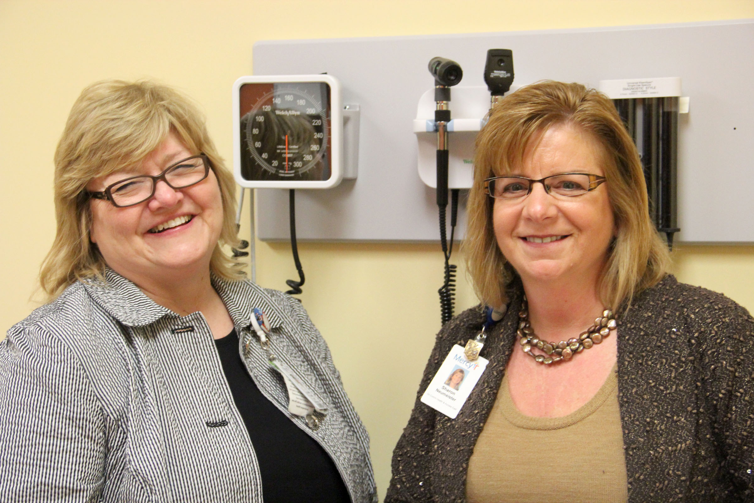 Nurse Practitioner Kathy Woods (left) and Sharron Neumeister, regional director of community health for Mercy (right), stand in an exam room in the health clinic at Roosevelt High School.